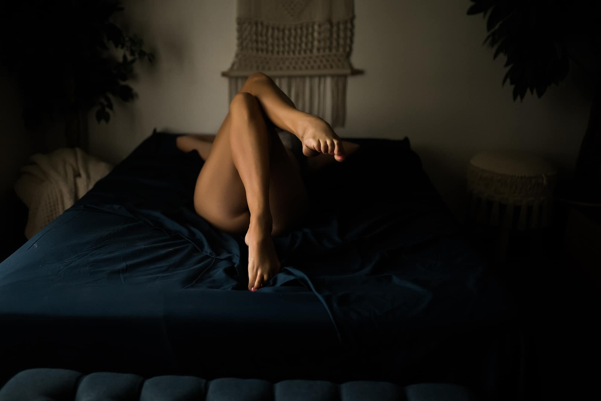 photo of feet on a bed taken in fort wayne